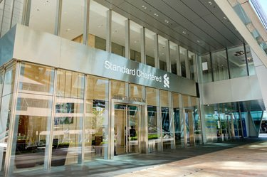 "Standard Chartered enters global resolution to settle ""egregious"" sanctions case"
