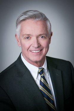 Kevin J Arquit