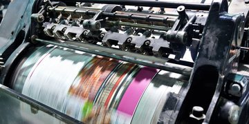 DOJ challenges printing deal