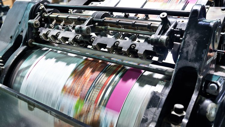 DOJ challenges printing deal