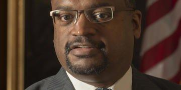 Judge pushes DOJ on efficiencies and arbitration